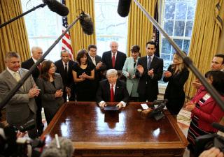 Image: Trump signs an executive order cutting regulations