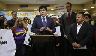 Image: State Sen. President Pro Tem Kevin de Leon discusses his measure SB54 after the Senate Pubic Safety Committee passed the bill on Jan. 31 in Sacramento, California.