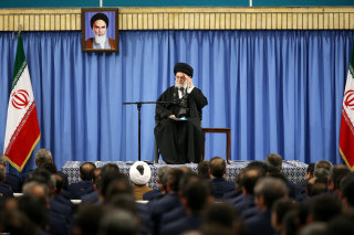 Image: Ayatollah Ali Khamenei waves as he delivers his speech Tuesday.
