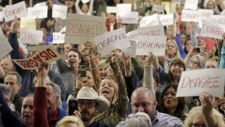 Image: Crowd reacts to Rep. Jason Chaffetz as he speaks during a town hall in Cottonwood Heights, Utah.