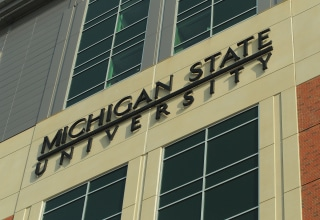 Image: A sign for Michigan State University is pictured on campus in East Lansing, Mich.