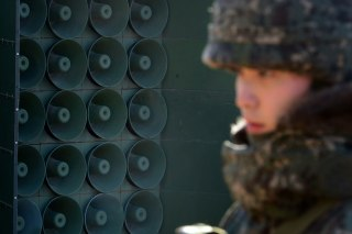 Image: A South Korean soldier stands next to the loudspeakers near the border area between South Korea and North Korea