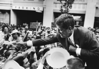 Image: Massachusetts Senator John F. Kennedy shakes hands with a crowd in Seattle