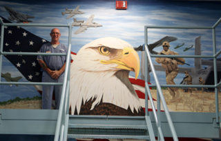 Image: Inmates in Florida's veteran dorms paint murals representing the service branches on prison wards.