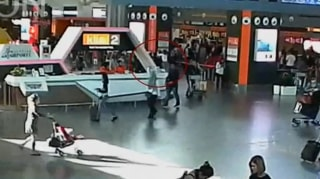 Image: Video grab appears to show a man purported to be Kim Jong Nam being accosted by a woman in a white shirt at Kuala Lumpur International Airport in Malaysia