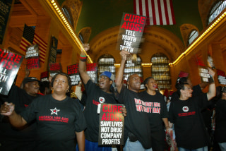 Image: AIDS activists protest in New York's Grand Central Station on Sept. 2, 2004, on the final day of the Republican National Convention.