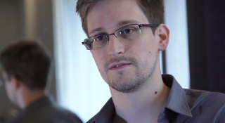 Image: In this handout photo provided by The Guardian, Edward Snowden speaks during an interview in Hong Kong.