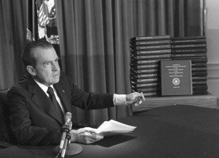 Image: President Richard M. Nixon is shown pointing to the transcripts of the White House tapes in this April 29, 1974, file photo.
