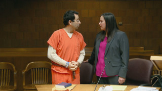 Image: Larry Nassar consults with his attorney before his arraignment in Ingham County court