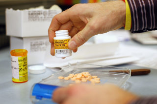 Image: A pharmacist fills a Suboxone prescription in Boston