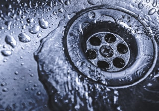 Image: Water goes down a sink drain