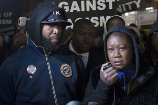 Image: Tracy Martin and Sybrina Fulton, the parents of Trayvon Martin, participate in a candlelight vigil to mark the anniversary of the shooting death of their son in New York, Feb. 26, 2013.