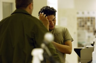 Image: Ronald Manolo Melendez is processed at the Eagle Pass Border Patrol Station in December 2006