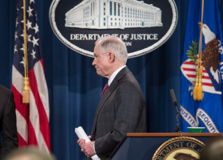 Image: Jeff Sessions walks away from the podium