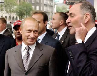 Image: Russian President Vladimir Putin listens to Senator Charles Schumer in September 2003