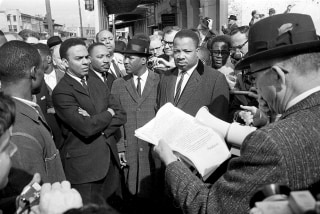 Image: A federal marshal reads a court order halting a planned voter registration protest march at Selma, Alabama, March 9, 1965.