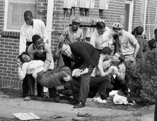 Image: Amelia Boynton is carried and another injured man tended to after they were injured when state police broke up a demonstration march in Selma, Alabama, March 7, 1965.