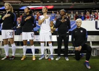 Image: Megan Rapinoe kneels during national anthem