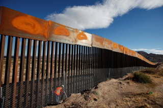 Image: FILE PHOTO: U.S. worker inspects a section of the U.S.-Mexico border wall at Sunland Park, U.S. opposite the Mexican border city of Ciudad Juarez