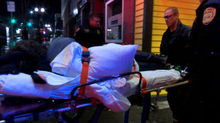 Image: Emergency workers remove a person who has overdosed from a bar in Everett, Wash.