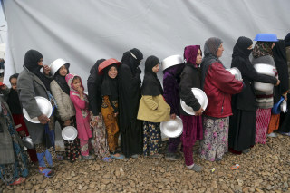 Image: Displaced Iraqis at the Hamam al-Alil camp