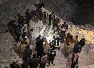 Image: Rescuers who were trapped under the debris