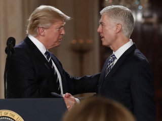 Image: President Donald Trump shakes hands with 10th U.S. Circuit Court of Appeals Judge Neil Gorsuch, his choice for Supreme Court Justices in the East Room of the White House in Washington, D.C. on Jan. 31.