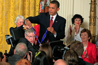 President Obama presents the Medal of Freedom to physicist Stephen Hawking in 2009.