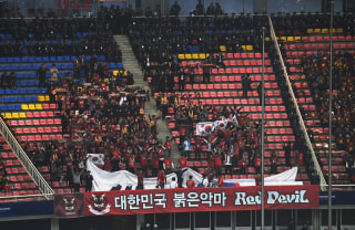 Image: Police and South Korea fans during World Cup qualifier on March 23, 2017
