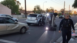 Image: A self-driven Volvo SUV owned and operated by Uber Technologies Inc. is flipped on its side after a collision in Tempe