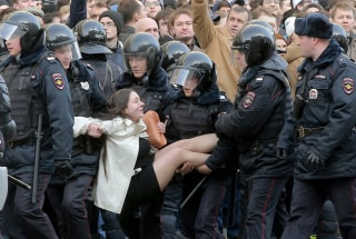 Image: Police detain a demonstrator at a rally Sunday in central Moscow