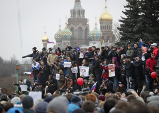 Image: Protesters gather at Marsivo Field in St. Petersburg.