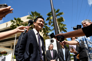 Image: Hawaii Attorney General Douglas Chin talks to the media