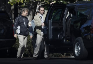 Image: A Secret Service agent opens the door of the presidential vehicle for Sen. Rand Paul, R-Ky, left, on the South Lawn driveway at the White House in Washington, April 2, 2017.