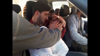 Image: Abdul-Hamid Alyousef holds his twin babies who were killed in Idlib on April 4.