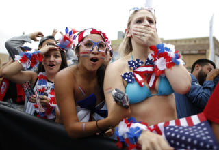 Image: U.S. fans react during the 2014 World Cup Group G soccer match between Germany and the U.S. at a viewing party in Hermosa Beach