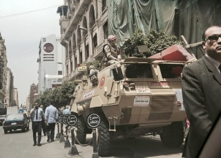 Image: Military soldiers guard a street near a church in downtown Cairo