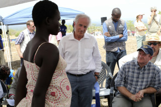 Image: U.S. Senators Bob Corker and Chris Coons speak with a South Sudanese refugee during a group discussion at the Bidi Bidi refugee settlement in northern Uganda, April 14, 2017.