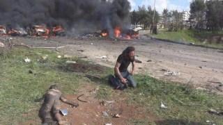 Image: Abd Alkader Habak cries on the ground
