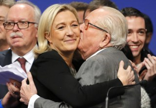 Image: French far-right Front National leader Marine Le Pen is kissed by her father Jean-Marie Le Pen