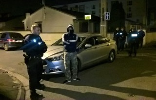 Image: Police search near the house of the suspected attacker