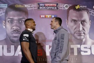 Image: British boxer Anthony Joshua, left, and Ukrainian boxer Wladimir Klitschko pose for the media