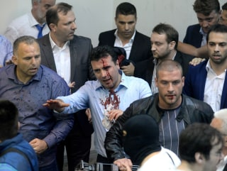 Image: Zoran Zaev, surrounded by security, leaves Parliament after protestors attacked him