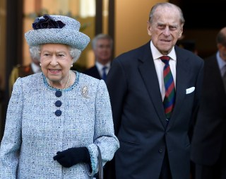 Image: Britain's Queen Elizabeth II and Prince Philip, the Duke of Edinburgh leave the National Army Museum in London