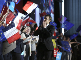 Image: French independent centrist presidential candidate Emmanuel Macron greets his supporters prior to his address during an election campaign rally