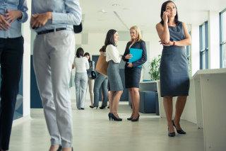 Image: Group of businesswomen in an office corridor