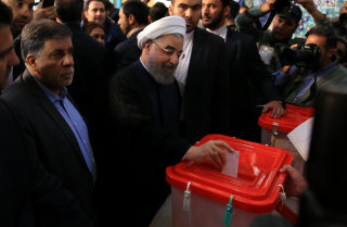Image: Iranian President Hassan Rouhani casts his vote