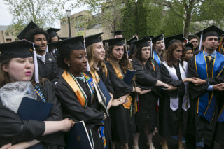 Image: Notre Dame students walk out of the commencement ceremony