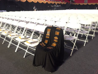 Image: A gown rests on a seat in honor of Lt. Richard Collins III at the Bowie State University graduation