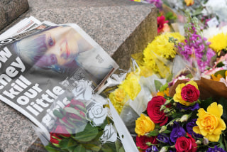 Image: Flowers and a newspaper at a vigil in Manchester